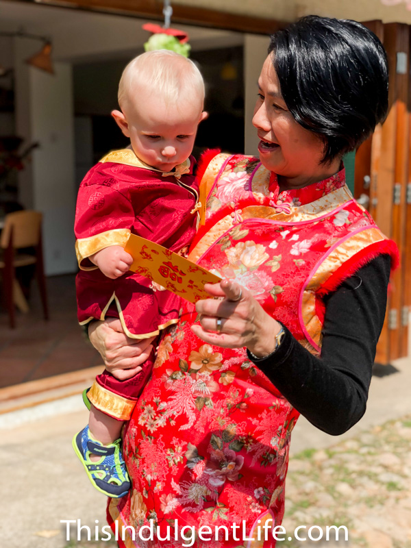 baby receiving lai see money during chinese new year