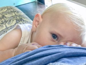 Toddler looking up while breastfeeding
