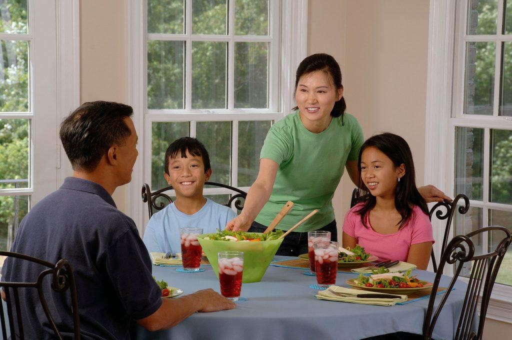 Family eating around dinner table
