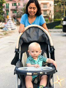 meet our domestic helper Theresa- helper pushing baby in stroller