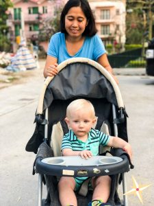 meet our domestic helper Theresa- helper pushing baby in stroller