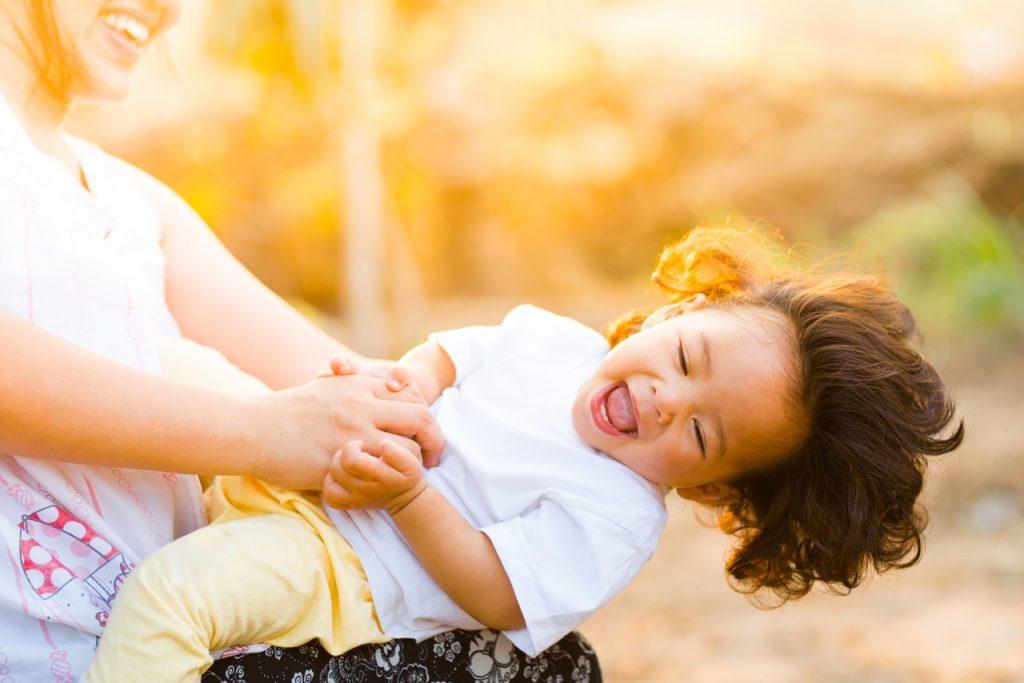 mom tickling child