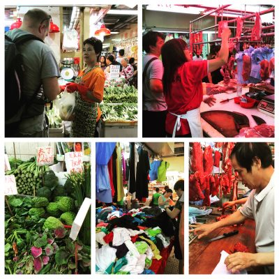 Hubby negotiates with a local in a wet market in Hong Kong for produce