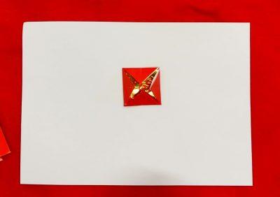 Step 6 of creating a red envelope lantern