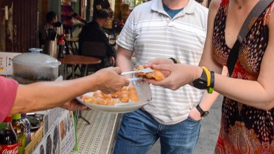 Sampling egg waffles for the first time in Tai O