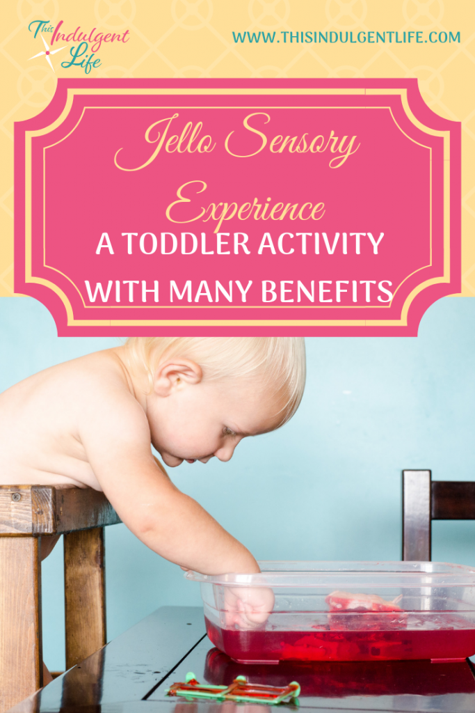 Jello Sensory Experience- A toddler Activity With Many Benefits | This Indulgent Life | This simple and cheap activity has many benefits for your toddler's development. There are also many extension activities and books that will make this activity a complete experience. | #jello #sensoryplay #sensorybins #sensoryactivitiestoddlers #toddleractivities #toddlerplay #toddlerlearning #sensorytoddlers #benefitsofsensoryplay #toddlerdevelopment
