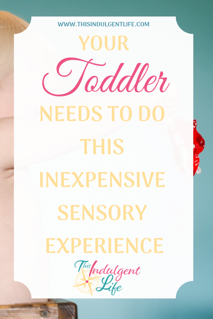 Your Toddler Needs to do This Inexpensive Sensory Experience | This Indulgent Life | This is an easy, cheap, and fun activity with many benefits for your toddler's development. | #jello #sensoryplay #sensorybins #sensoryactivitiestoddlers #toddleractivities #toddlerplay #toddlerlearning #benefitsofsensoryplay #toddlerdevelopment #sensorytoddlers