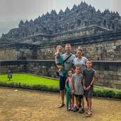our squad abroad around the world adventure with a large family in front of a temple