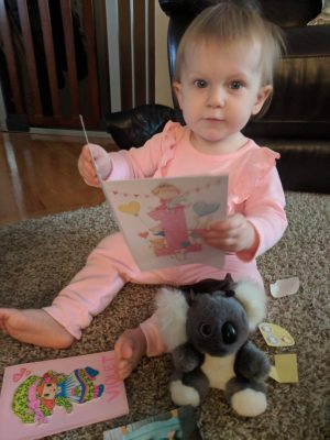 Violet looking through her goodies from her Australian Penpal, Sophia