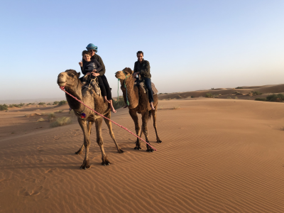 Kirsty and her family on a camel- Luxury family travel in africa