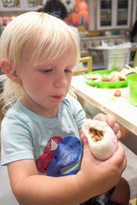 Boogie eating a pork bun at Yum Cha